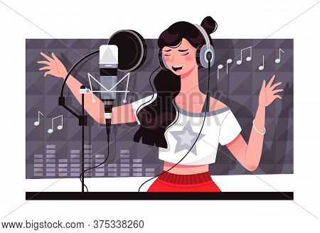 Young Caucasian Vocalist Recording A Sound Track At A Music Studio With A Woman Standing In Front Of