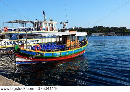 Sliema, Malta - April 21: The Traditional Maltese Luzzu Boat For Tourists Cruises On April 21, 2015