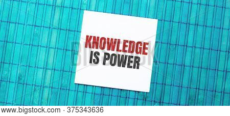 Blank Note Pad With Knowledge Is Power Text On Green Wooden Background