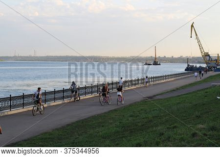 Russia, Saratov - July, 20202: People Walk Along The Embankment After A Long Period Of Self-isolatio