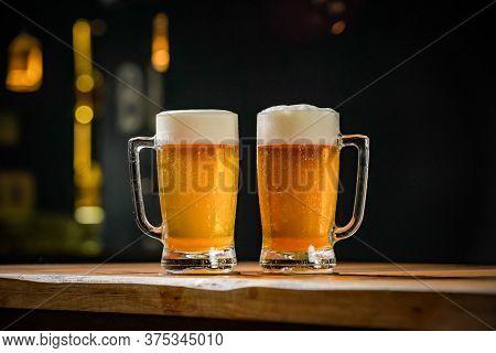mug full of chopp, with chopp pilsen on a rustic table