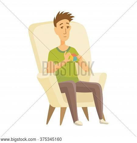 Home Leisure. Boy Sit On Chair And Playing Rubik Cube. Young People Leisure Time. Staying At Home. E