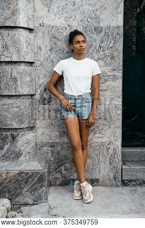 Portrait Of Attractive Afro American Woman On Shorts And T-shorts At Gray Background