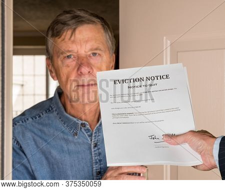 Open Front Door With Man In Suit Handing An Eviction Notice To A Defaulting Renter In Modern Home Du