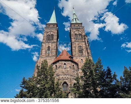 Nuremberg, Germany - June 4 2020: Famous St. Sebaldus Church Facade In Nuremberg, Germany, Over Deep