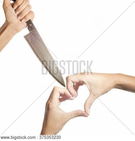Love-hate Concept, Hand Wielding A Knife And Hands Forming A Heart Isolated On White