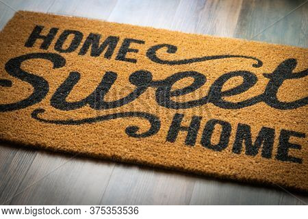 Home Sweet Home Welcome Mat Resting on Floor.