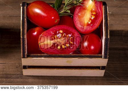 Wooden Box With Tomatoes And Oregano Twig
