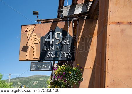 Jackson, Wyoming - Junen 26, 2020: Sign For The 49er Inn And Suites, A Hotel Located In Downtown Jac