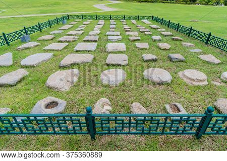 Collection Of Large Stones Excavated At Archeological Site In Buyeo, South Korea Inside Iron Fence