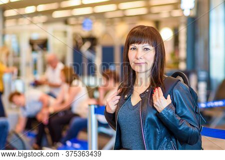 Woman Solo Traveller With Backpack In The Airport.