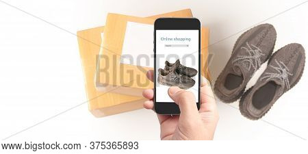 Hand Holding Smartphone Device And Touching Screen, Business Owner Working. Online Shopping Sme Entr