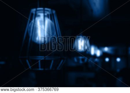 Abstract Blurr Pendant Burning Lamps For Interior Decoration Glow In The Dark. Lamps Hang In A Row.