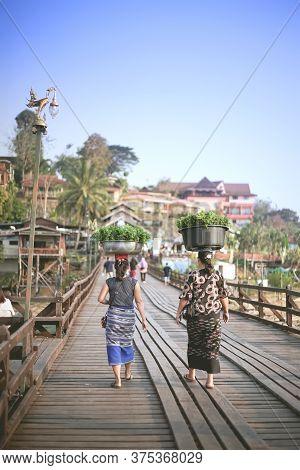 Kanchanaburi, Thailand - January 17, 2020 : Vegetable Vendors With Basin On Head Are Walking On The