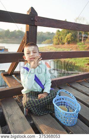 Kanchanaburi, Thailand - January 16, 2020 : Asian Kid With Powder At Mon Bridge, Sangkhla Buri, Kanc