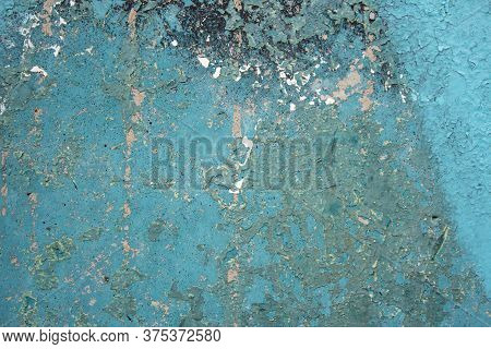 Cracked Flaking Turquoise Paint On A Metal Surface. Old Weathered Painted Turquoise Plastered Peeled