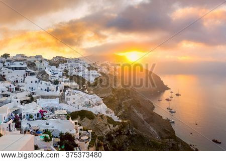 Ave sunrise morning view of Santorini island, Greece. Picturesque sunrise on the famous Greek resort Oia, Greece, Europe.