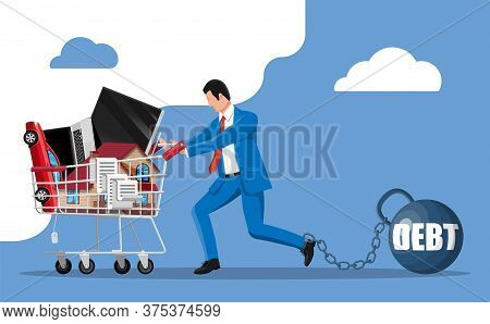 Businessman Chained To Big Heavy Debt Weight With Shackles, Pulling Shopping Cart With With House Bu