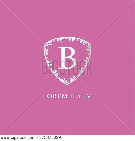B Letter Intial Logo Design Template Isolated On Pink Background. Luxury Silver Decorative Floral Sh