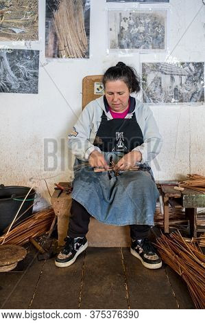 Camacha, Madeira, Portugal - April 19, 2018: A Basket Weaver At Work In The Factory Shop In Camacha