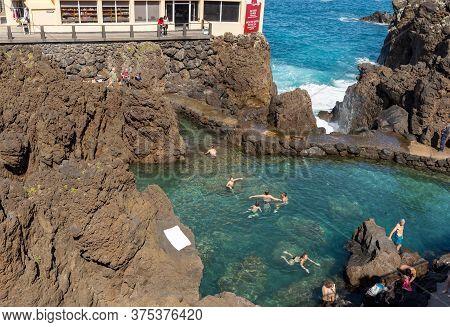 Porto Moniz, Madeira, Portugal - April 18, 2018: Natural Rock Pool Of Porto Moniz On Madeira Island.