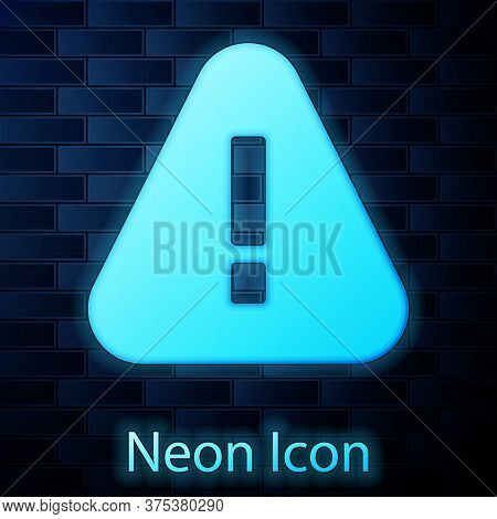 Glowing Neon Exclamation Mark In Triangle Icon Isolated On Brick Wall Background. Hazard Warning Sig