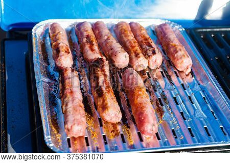 Sausages Meat Grilling On Gas Grill