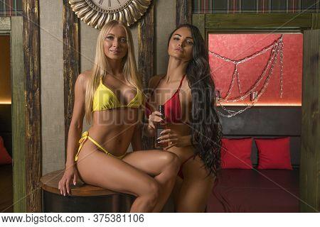 Voluptuous Women In Bikini In Creative Studio