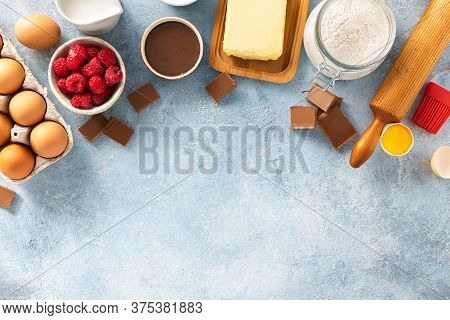 Ingredients For Cooking Raspberries And Chocolate Pie With Copy Space Top View Bakery Background