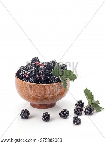 Blackberries In A Wooden Bow. Ripe And Tasty Black Berry Isolated On White. Blackberries On A White