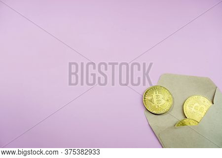 Top View Of Envelope With Golden Bitcoin Coins As A Gift. There Are Big Golden Btc Cryptocurrency Co