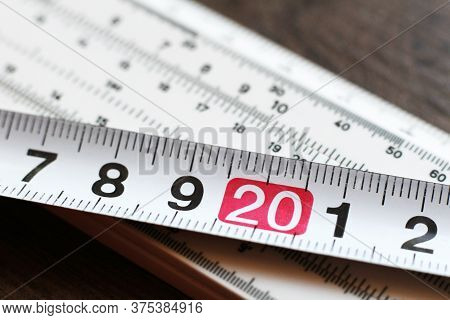 Measuring Tool And Tape Measure So Close