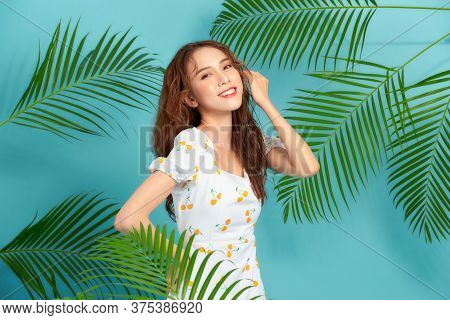 Beautiful Young Asian Woman With Healthy Skin On Color Background