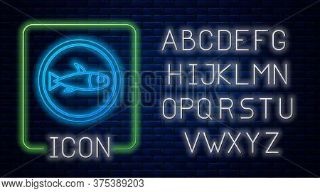 Glowing Neon Served Fish On A Plate Icon Isolated On Brick Wall Background. Neon Light Alphabet. Vec