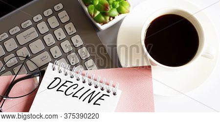 Office Supplies, Devices, Coffee Cup And Glasses On White Table With Text Decline