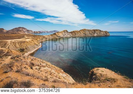 Picturesque Landscape Of The Black Sea, Cape And Blue Lagoon Panoramic View. Travel Holiday Destinat