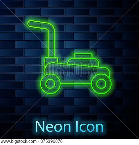 Glowing Neon Line Lawn Mower Icon Isolated On Brick Wall Background. Lawn Mower Cutting Grass. Vecto