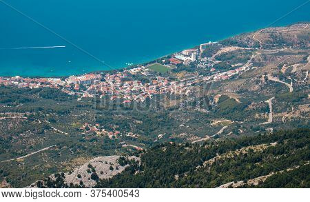 Zoomed In View Of The Town Of Tucepi, Seen From The Biokovo Mountain Twenty Kilometers Away. Small T