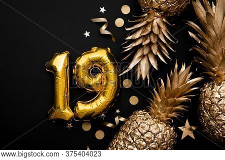 19th Birthday Celebration Background With Gold Balloons And Golden Pineapples