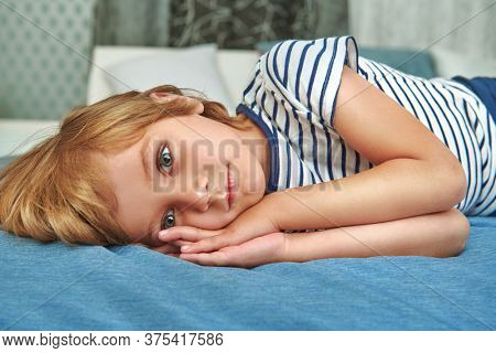 Cute little boy falls asleep at his bedroom. Happy family and love concept.