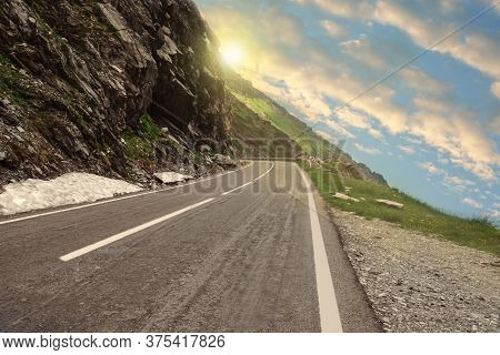 Road Trip. Beautiful View Of Asphalt Highway Along Crag On Sunny Day