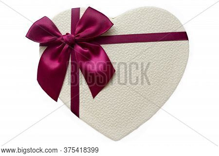 Gift Box In Form Heart On White Background