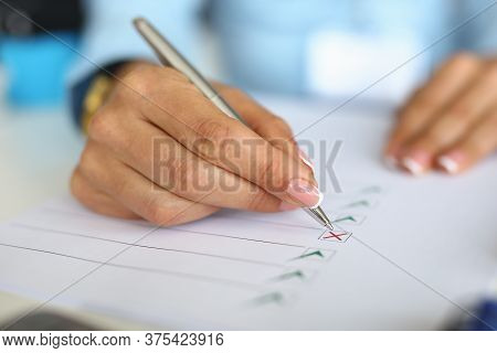 Woman Fills Out Questionnaire By Ticking Document. Business Development Planning Concept