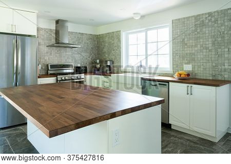 New Grey And White Kitchen With Appliances And Timber Bench Top