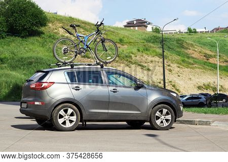 Bicycle Transportation On Kia Sportage - Two Bicycle On The Roof Of A Car. A Car With A Mount On The