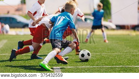 Soccer Players Running With Soccer Ball Action. Kids On School Sports Competition. Horizontal Soccer