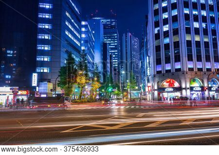 TOKYO, JAPAN - NOVEMBER 14, 2016: Cityscape of Shinjuku district with traffic lights on the street of Tokyo, Japan. Tokyo Metropolis is both the capital and most populous city of Japan.