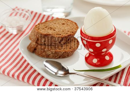 A boiled egg and bread