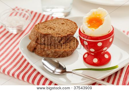 Soft-boiled egg and bread