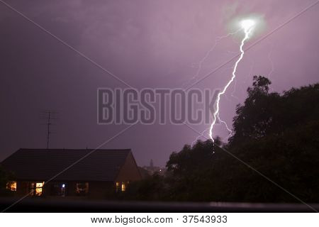 Lightning bolt shoots from the sky, lighting up the sky